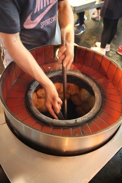 Taiwan street food: Black pepper buns in the oven at Raohe Night Market, Taipei, Taiwan