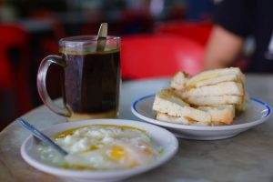 Kopi, soft boiled eggs and kaya toast